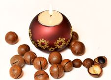 Free Candle And Macadamia Nuts Royalty Free Stock Images - 28463999