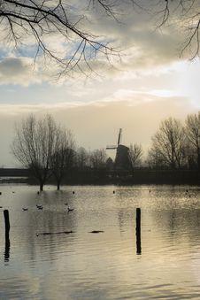 Windmill And Flodd Stock Photo