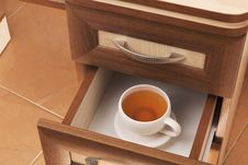 Free Cup Of Tea In Desk Drawer Royalty Free Stock Photo - 28483535