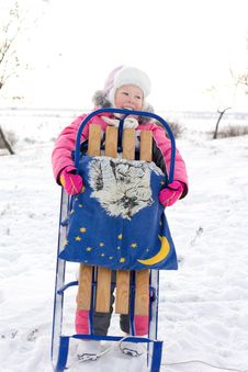 Free Merry Little Girl Holding Her Winter Sled Royalty Free Stock Image - 28485066