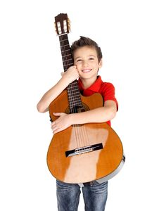Smiling Boy Holding Acoustic Guitar Stock Images