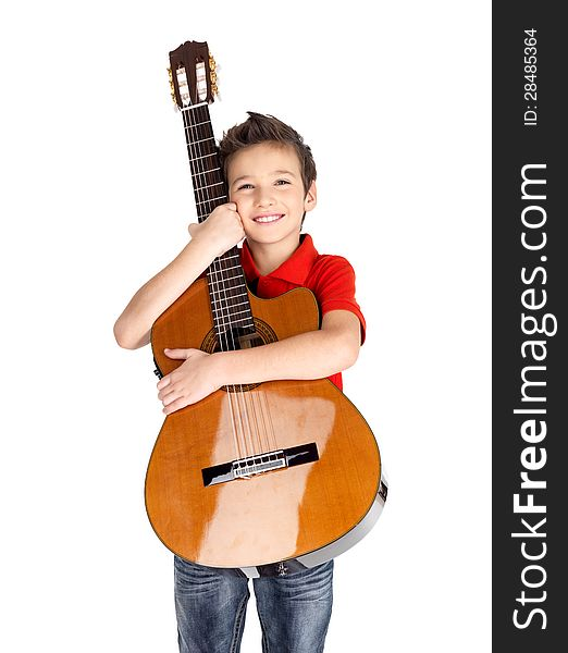 Smiling boy holding acoustic guitar