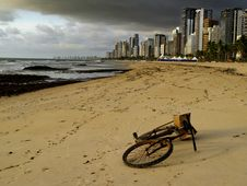 Free Bicycle Lying On The Sand Of A Beach In Brazil Stock Photography - 28497542
