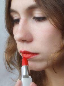 Girl & Lipstick Royalty Free Stock Photos