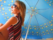 Free Girl Sitting Under An Umbrella Stock Photography - 2854622