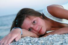 Young Woman Lying On Beach Royalty Free Stock Images