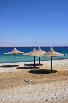Free Empty Beach Blue Water And Sun Stock Photos - 2855653