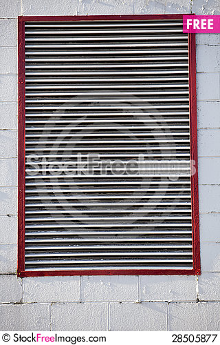 Free Large Industrial Vent On Cinder Block Wall Royalty Free Stock Photography - 28505877