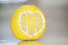 Free Love Hurts Concept With An Orange Fruit And Pins Royalty Free Stock Images - 28545569