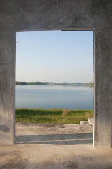 Looking Out Of Open Door Upon Lake Royalty Free Stock Images