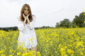 Free Brunette Woman In A Yellow Flowers Field Stock Photography - 28551532