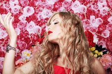 Beautiful Fashion Girl With Red Makeup And Roses. Royalty Free Stock Image