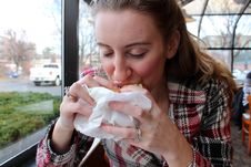 Pretty Blonde Eating Mouthwatering Sandwich Royalty Free Stock Images