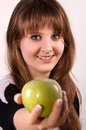 Free Teen Girl Holding An Apple. Royalty Free Stock Photo - 28590015