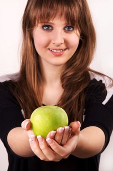 Free Teen Girl Holding An Apple. Royalty Free Stock Photo - 28590145