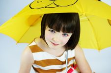 Free Young Girl Under Umbrella 3 Royalty Free Stock Image - 28591726