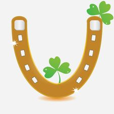 Free Horseshoe And Four Leaf Clover. Stock Photo - 28597840