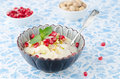 Free Semolina Dessert With Pomegranate Seeds And Pistachios In A Bowl Royalty Free Stock Images - 28602699