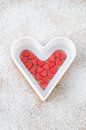 Free Sugar Hearts In White Baking Dish On A Board Sprinkled With Powd Royalty Free Stock Image - 28602786