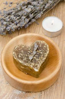 Free Bath Soap With Lavender In A Heart And A Candle On A Wooden Tabl Stock Image - 28602341