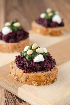 Beet Salad With Pesto And Goat Cheese On Toasted Grain Breads On Royalty Free Stock Photos