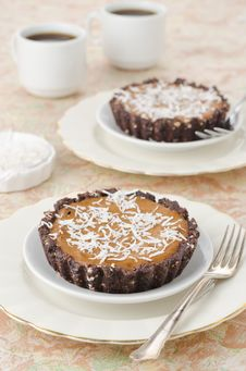 Free Chocolate Tarts With Cream And Coffee Royalty Free Stock Image - 28602436