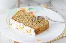 Piece Of Cake On A Plate Of Orange Horizontal Stock Image