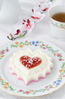 Two-layer Dessert Of Cream And Jam And Coconut On A Plate Royalty Free Stock Photography