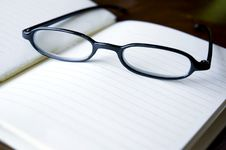 Free Eyeglasses On Notebook Royalty Free Stock Image - 28604076