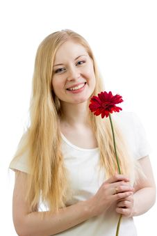 Portrait Of A Young Happy Woman With Flower