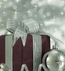 Free Christmas Present With Silver Bauble. Stock Photo - 28620590