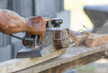 Free Carpenter Working With Electric Planer Stock Image - 28638881