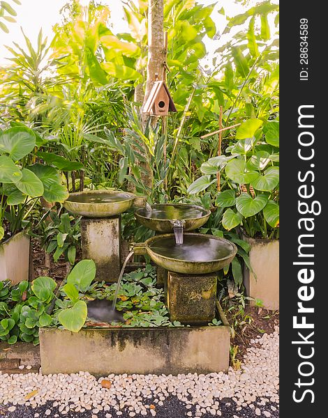 Man-made small waterfall in garden
