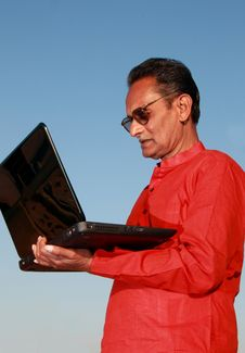 Free Old Indian Man Using Laptop Stock Images - 28642594