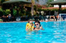 Family Rest In Pool Royalty Free Stock Photography