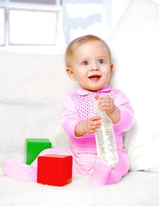 Free Portrait Of A Cheerful Little Girl Drinking Water From A Bottle Stock Photo - 28646770