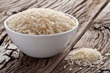 Uncooked Rice In A Bowl Royalty Free Stock Photo