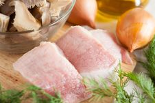 Two Pieces Of Raw Pork On Board Stock Photo