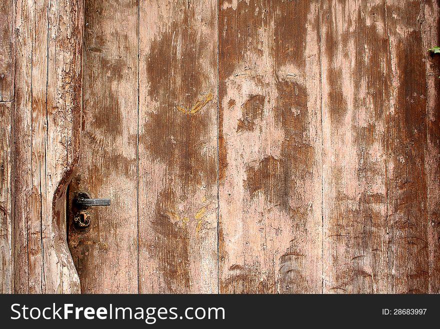 Old brown wooden door as antique background