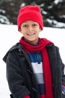 Free Happy East Indian Boy Playing In The Snow Royalty Free Stock Photography - 28699067