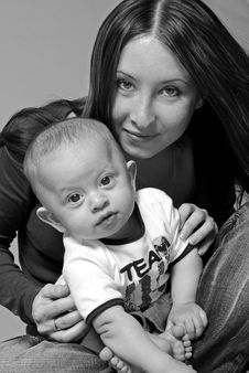 Free Mother With A Child In Her Lap Royalty Free Stock Photography - 2872287