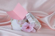 Gift Box And A Pink Flowe Royalty Free Stock Images