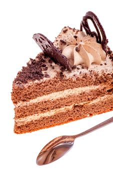 Piece Of Cake And Tea-spoon Royalty Free Stock Photo
