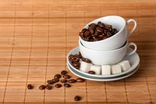Free White Cups And Coffee Grains On A Saucer With Sugar Royalty Free Stock Images - 28734499