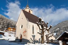Free A Wintertime View Of A Small Church With A Tall Steeple Stock Photos - 28742283