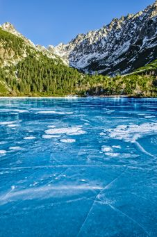 Mountain Ice Lake With Cracked Textured Ice Stock Image