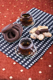 Two Cups Of Tea With Two Plates With Cookies Stock Photo