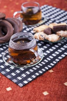 Two Cups Of Tea With Two Plates With Cookies Stock Photos