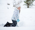 Free Child Making Snowman In Winter Park Stock Images - 28763994