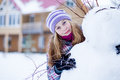 Free Teenager Girl Making Snowman Outdoors In Front Of House Royalty Free Stock Images - 28764249
